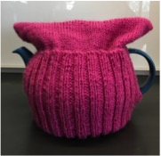 Pink teapot cosy