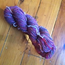 Skein of purple merino wool blended by megan