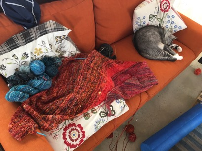 Skeins of yarn on sofa