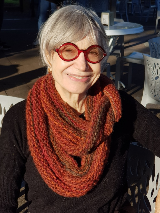Susan Solomon with red-brown knitted scarf